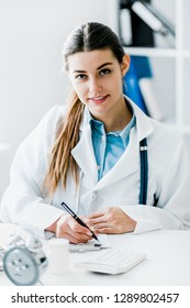Female doctor working at office desk,  healthcare professionals.
