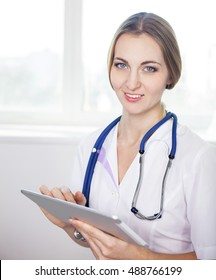 Female doctor working with tablet computer