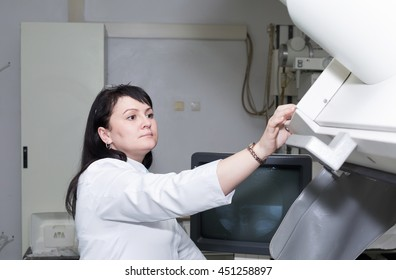 A female doctor working with x-ray machine