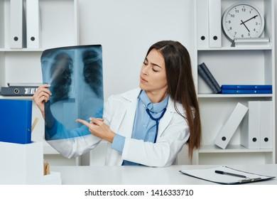 female doctor x-ray office medicine examination professional radiologist