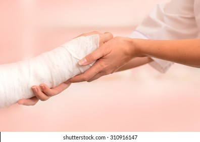 Female Doctor and young boy with a broken arm