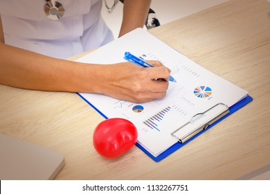 female doctor,nurse,pharmacy with stethoscope on hospital holding clipboard,writing a prescription,Medical