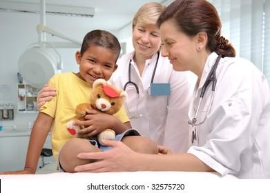 female doctors examining little child boy
