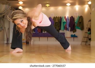 female doing yoga in a studio