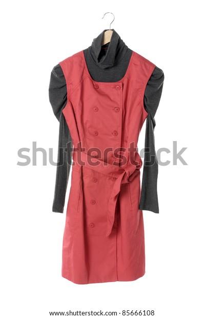 female dress isolate on a wooden hanger