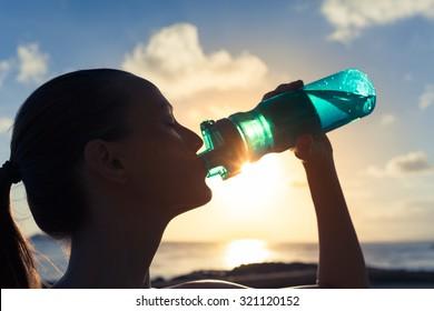 Female drinking a bottle of water