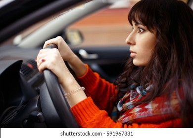 Female driver with pop-eyed look