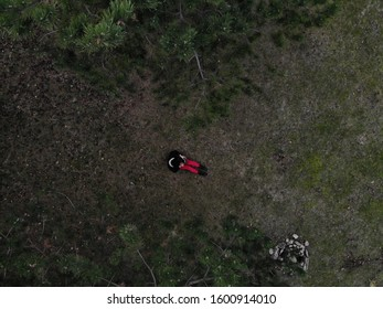 Female Drone Pilot Holding a Drone Controller and taking a selfie in a Forest during Winter time