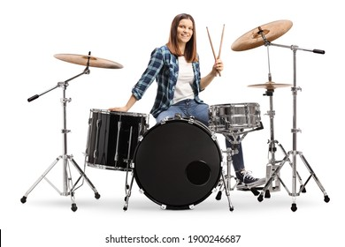 Female drummer with a drum set isolated on white background