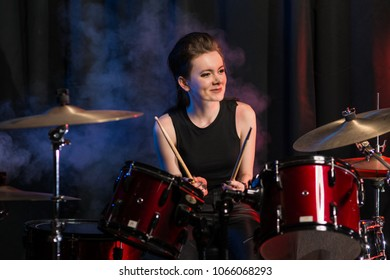 Female drummer at drumset in club
