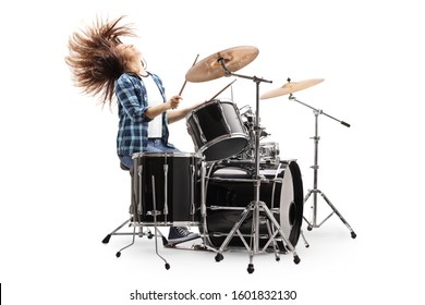 Female drummer playing on a drum set and throwing hair back isolated on white background