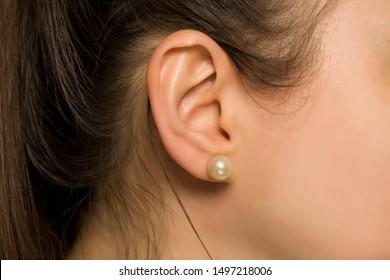 female ear with pearl earring