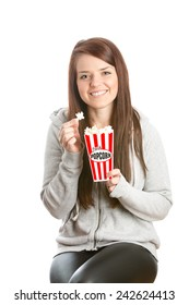 Female Eating Popcorn - This is a shot of a beautiful young woman enjoying some popcorn. Shot on an isolated white background.