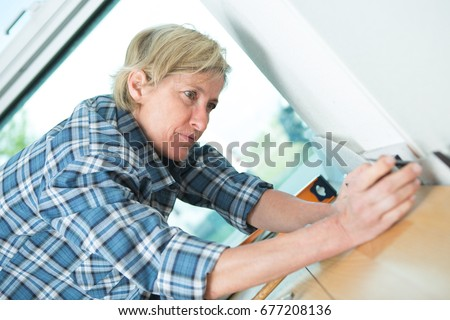 female electrician fixing socket