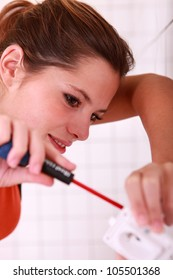 Female electrician with screwdriver