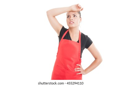 Female employee on hypermarket looking tired after work isolated on white background with copyspace