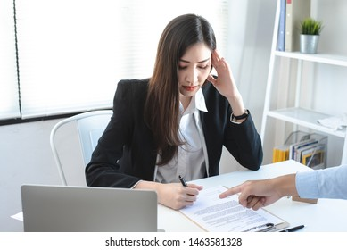 Female employees feel stressed when forced to sign papers with reluctance.