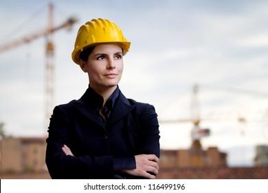 female engineer against building yard