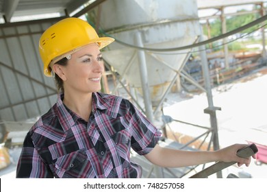 female engineer in contemporary cement factory