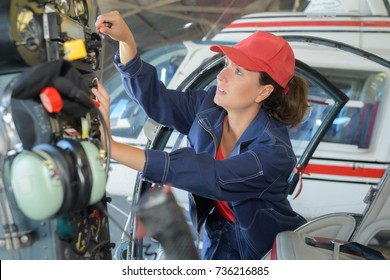 female engineer fixing the engine of the airplane