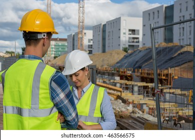 Female engineer and foreman working together