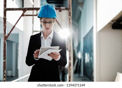 Female engineer in hardhat