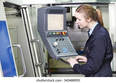 Female Engineer Operating Computerized Cutting Machine