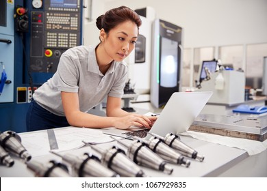 Female Engineer Using CAD Programming Software On Laptop