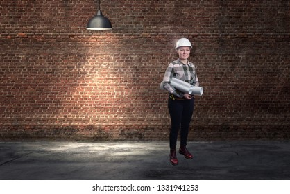 A female engineer in white helmet against red brick wall background. 3d render elements in collage