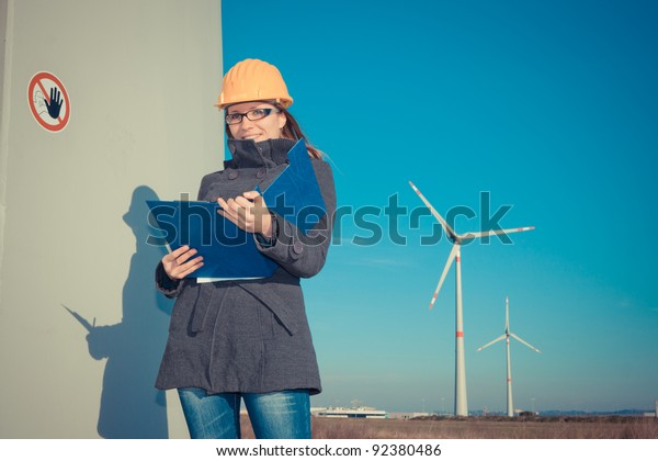 Female Engineer in Wind Turbine Power Generator Station