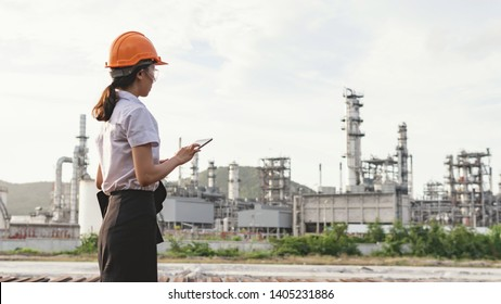 Female engineers view tablet information in the industrial area.