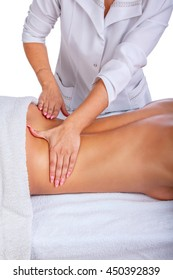 Female enjoing relaxing back massage in therapist centre.