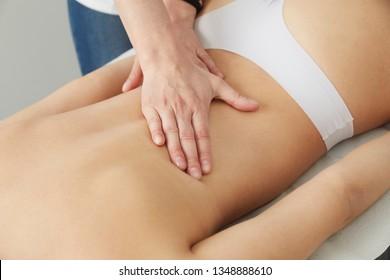 Female Enjoying Relaxing  Massage In Cosmetology Spa Center