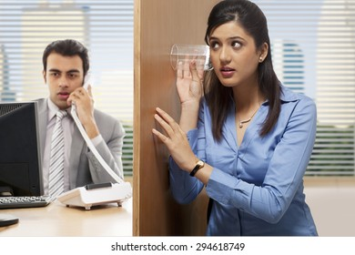 Female executive eavesdropping on a conversation