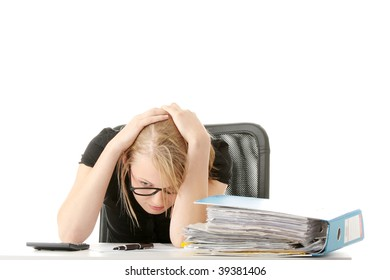 Female executive filling out tax forms while sitting at her desk. Isolated