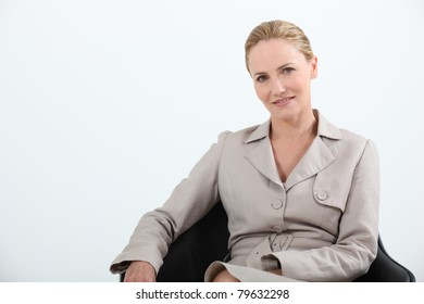 Female executive sitting in leather chair