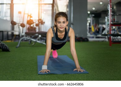 Female exercising  push ups