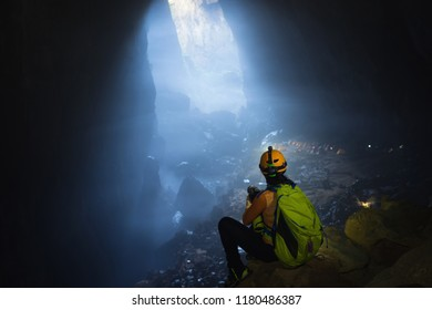Female explorer seeing mystery scene in Son Doong Cave, the largest cave in the world in UNESCO World Heritage Site Phong Nha-Ke Bang National Park, Quang Binh province, Vietnam