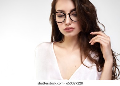 Female Eye wear. Attractive Brunette Girl With Natural Face Makeup In Transparent Glasses Frame.