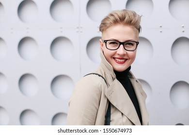 Female eye wear. Attractive girl with red lips makeup in transparent glasses frame. Beautiful business lady