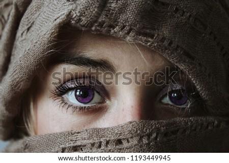 Female eyes in cape