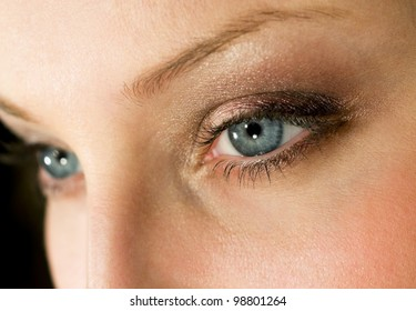 Female eyes with dark brown make-up