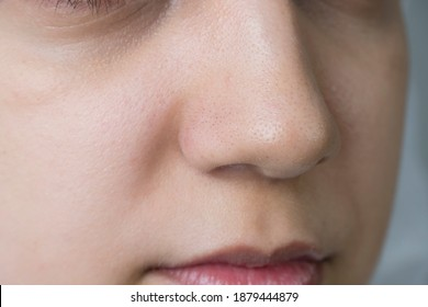 Female face close up. Girl without makeup in the bathroom. Black dots on the nose. Skin care, problem skin, cleansing. Natural beauty, naturalness. Blackheads and comedones. Pores and acne on the nose - Shutterstock ID 1879444879