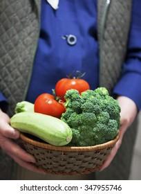 female farmer holding vegetable basket