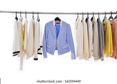 female fashion clothing, jacket on hangers at the show