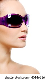 Female fashion model in purple sunglasses with a clean pure skin - isolated on white