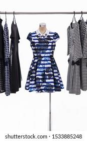 female fashion pattern ,dress, on mannequin with different stripy,black sundress on hanger