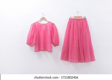 female fashion pink clothes and pink skirt on white background