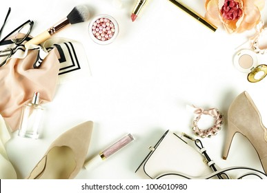 Female fashionable stylish accessories and make up cosmetics. Beige shoes with heels, bag, headscarf, glasses, lipstick, mascara, powder, brush, parfume on a white background.  Copy space.Flat lay.top