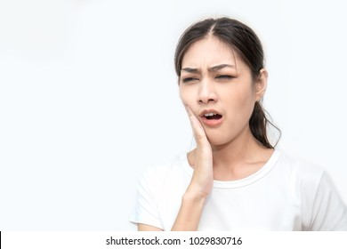 Female feeling painful toothache. Teeth problem woman feeling tooth pain. Closeup of beautiful sad girl suffering from strong tooth pain. Dental health and care concept.